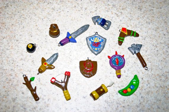 image of Legend of Zelda charms by Geekout Props | TheGeekPages.com